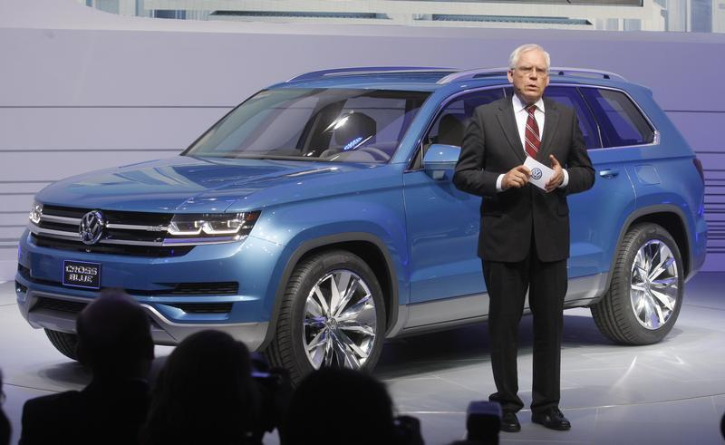 VW's Hackenberg speaks next to the 2014 Touran Cross Blue at the North American International Auto Show in Detroit