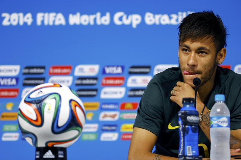 Brazil's Neymar listens to reporters' questions before his team's final practice in Sao Paulo
