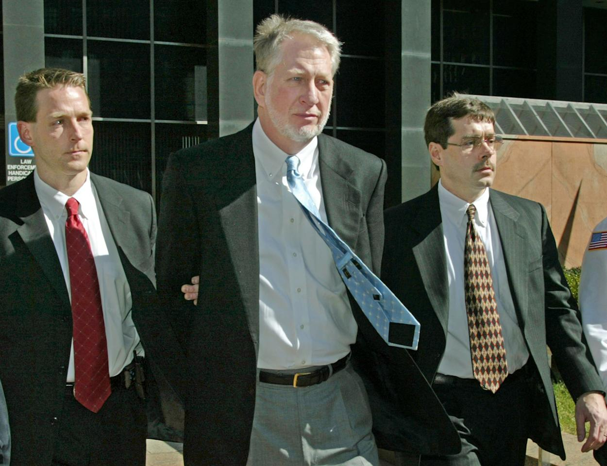 Bernie Ebbers is currently serving a 25-year sentence at the Oakdale Federal Correctional Institution in Louisiana. The former WorldCom CEO was convicted in 2005 of conspiracy, securities fraud and filing false documents with regulators after his involvement in an $11 billion fraud within the company. Photo: Former WorldCom executive Bernie Ebbers, center, leaves the federal building for an arraignment in custody March 3, 2004 in New York City.
