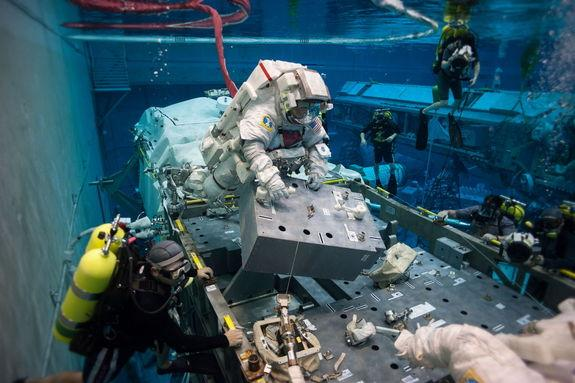 On May 10, 2013, NASA astronaut Terry Virts simulates extravehicular activity in the Johnson Space Center's Neutral Buoyancy Laboratory. His session, in which he was joined by European Space Agency astronaut Samantha Cristoforetti (out of frame
