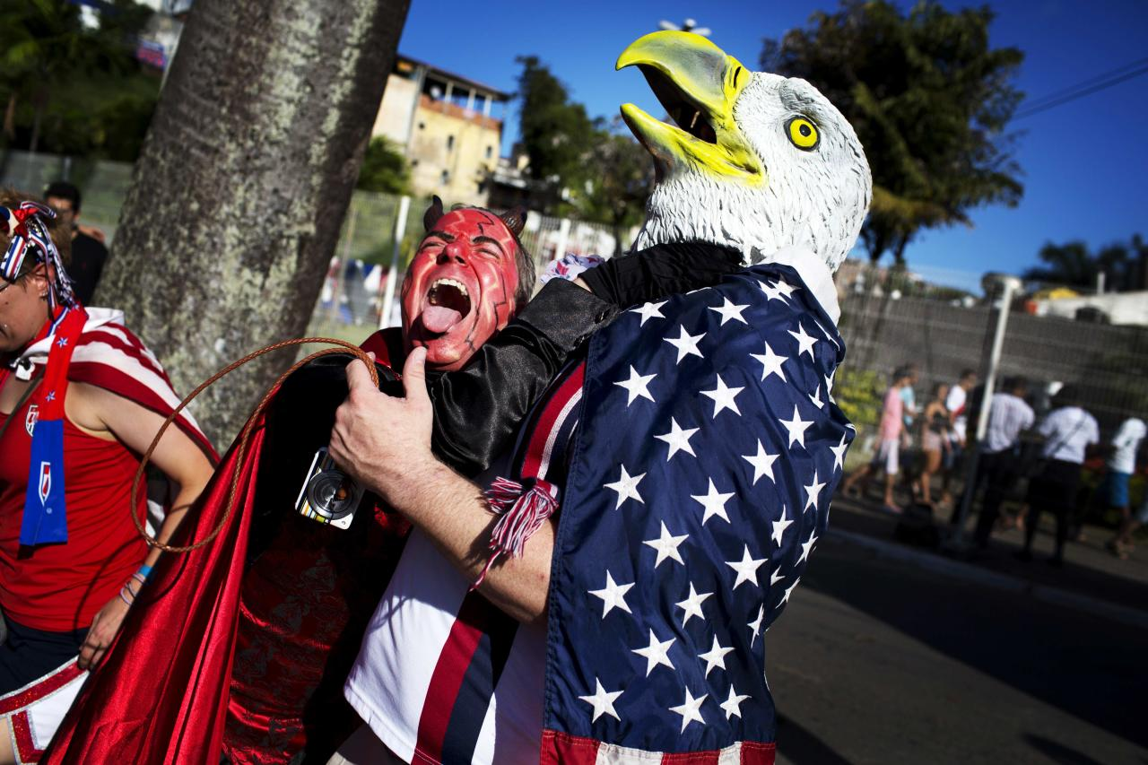 U.S. and Belgium soccer fans cheer together before a World Cup round of 16 match between U.S. and Belgium in Salvador, Brazil, Tuesday, July 1, 2014. (AP Photo/Rodrigo Abd)