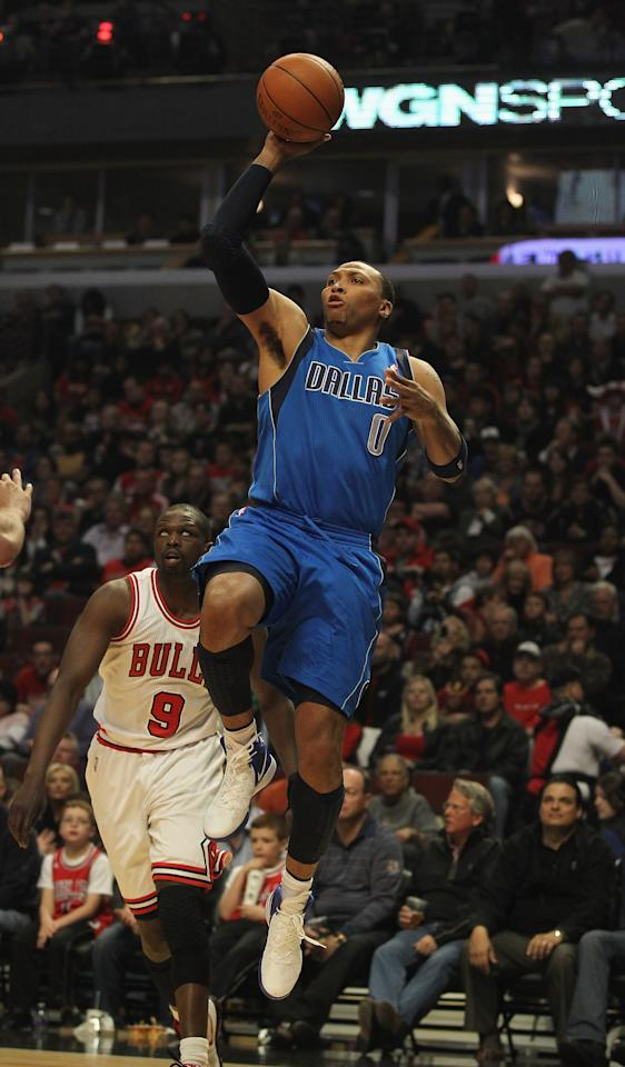 CHICAGO, IL - APRIL 21: Shawn Marion #0 of the Dallas Mavericks shoots past Loul Deng #9 of the Chicago Bulls at the United Center on April 21, 2012 in Chicago, Illinois. NOTE TO USER: User expressly acknowledges and agress that, by downloading and/or using this photograph, User is consenting to the terms and conditions of the Getty Images License Agreement.  (Photo by Jonathan Daniel/Getty Images)