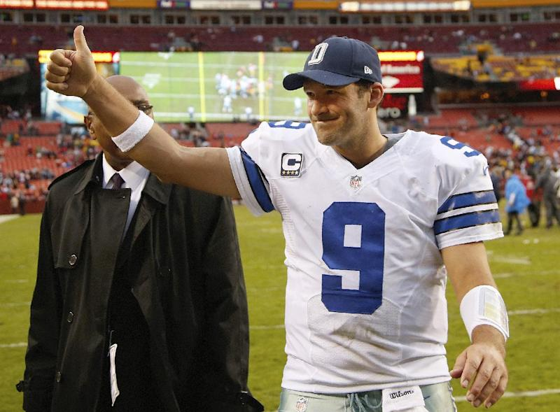Dallas Cowboys quarterback Tony Romo flashes a thumbs-up as he walks off the field after the Cowboys defeated the Washington Redsksins 24-23 in an NFL football game in Landover, Md., Sunday, Dec. 22, 2013