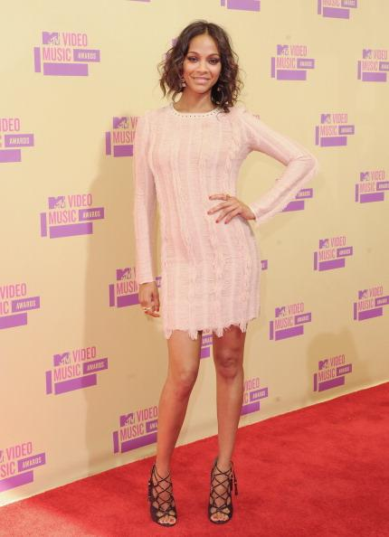 "<div class=""caption-credit""> Photo by: Getty Images</div><div class=""caption-title"">Saldana at the MTV VMAs</div>The Dominican actress proved she can play with the cool, musical crowd when she wore this Salvatore Ferragamo lacy mini dress to the Video Music Awards. The result? A spot as one of the night's best-dressed stars."