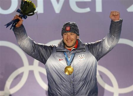 Gold medallist Miller celebrates during the medals ceremony for the men's super combined alpine skiing during the Vancouver 2010 Winter Olympics