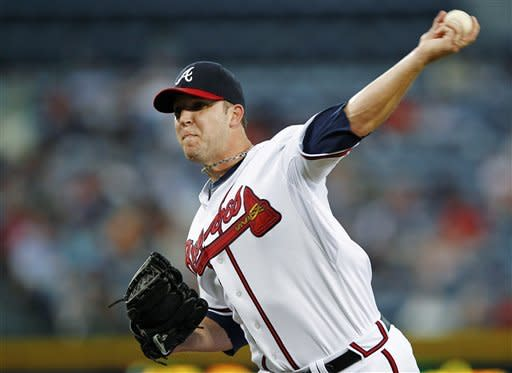 Atlanta Braves starting pitcher Paul Maholm (17) works against the Miami Marlins in the first inning of a baseball game in Atlanta, Wednesday, Sept. 26, 2012. (AP Photo/John Bazemore)