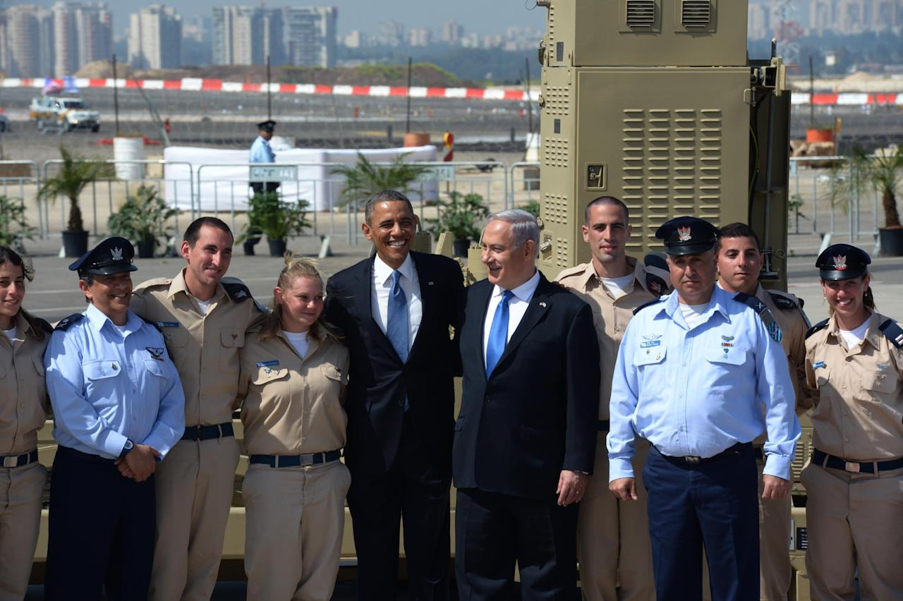 TEL AVIV, ISRAEL - MARCH 20:  (ISRAEL OUT) In this handout image supplied by the Government Press Office of Israel (GPO), US President Barack Obama and Israeli President Benjamin Nethanyahu pose with members of the military at Ben Gurion International Airport on March 20, 2013 near Tel Aviv, Israel.  This will be Obama's first visit as President to the region, and his itinerary will include meetings with the Palestinian and Israeli leaders as well as a visit to the Church of the Nativity in Bethlehem. (Photo by Moshe Milner/GPO via Getty Iimages)