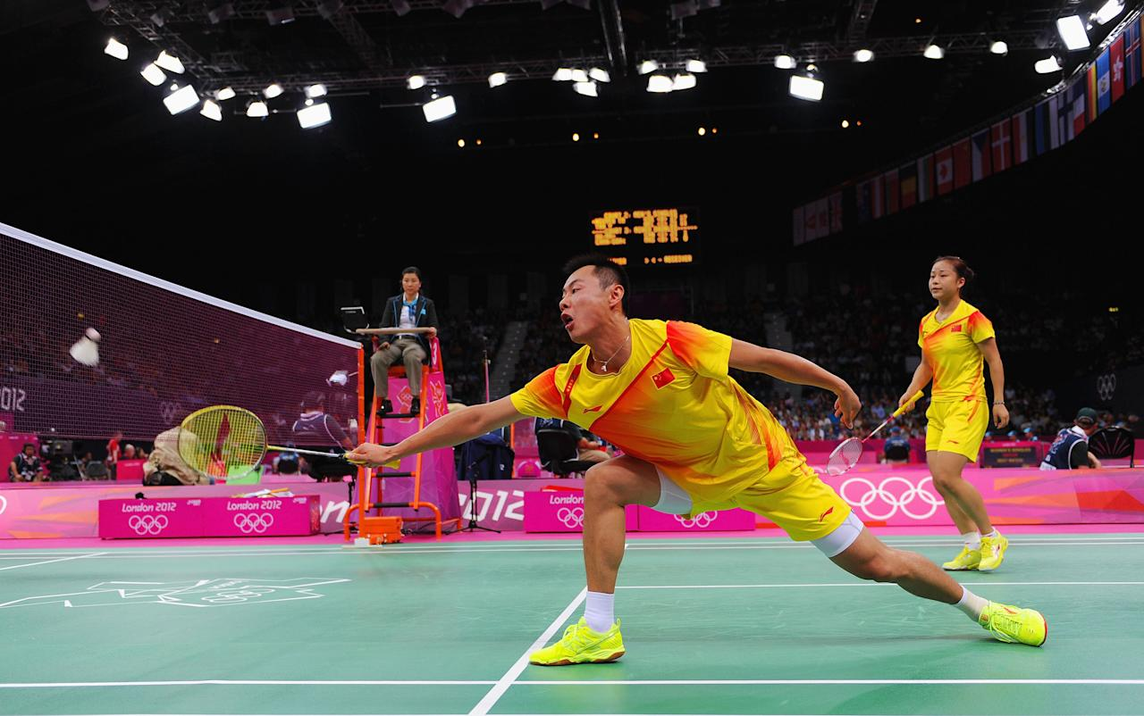 LONDON, ENGLAND - JULY 29:  Chen Xu (L) and Jin Ma (R) of China return a shot against Peng Soon Chan and  Liu Ying Gohon of Malaysia during their Mixed Doubles Badminton on Day 2 of the London 2012 Olympic Games at Wembley Arena on July 29, 2012 in London, England.  (Photo by Michael Regan/Getty Images)