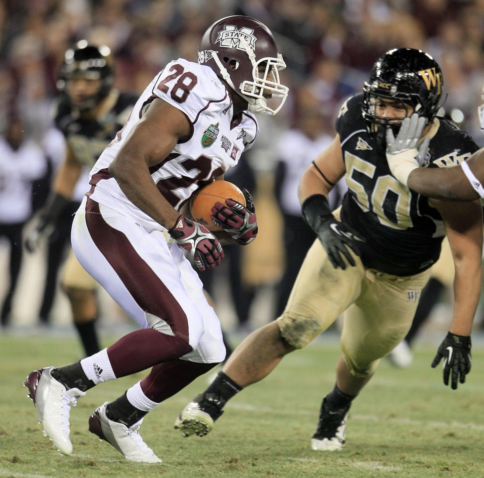 Mississippi State running back Vick Ballard (28) gets past Wake Forest defensive tackle Nikita Whitlock (50) on a 60-yard touchdown run in the first quarter of the Music City Bowl NCAA college football game on Friday, Dec. 30, 2011, in Nashville, Tenn. (AP Photo/Mark Humphrey)