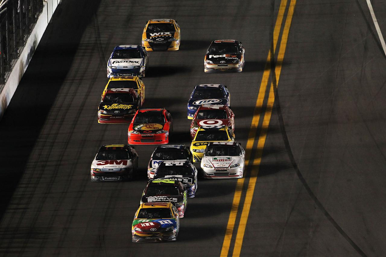 DAYTONA BEACH, FL - FEBRUARY 18: Kyle Busch, driver of the #18 M&M's Brown Toyota, leads a pack of cars during the NASCAR Budweiser Shootout at Daytona International Speedway on February 18, 2012 in Daytona Beach, Florida.  (Photo by Jamie Squire/Getty Images)