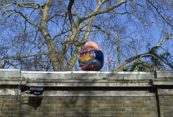 A Humpty Dumpty egg sits on the wall of Clarence House in London March 8, 2012.