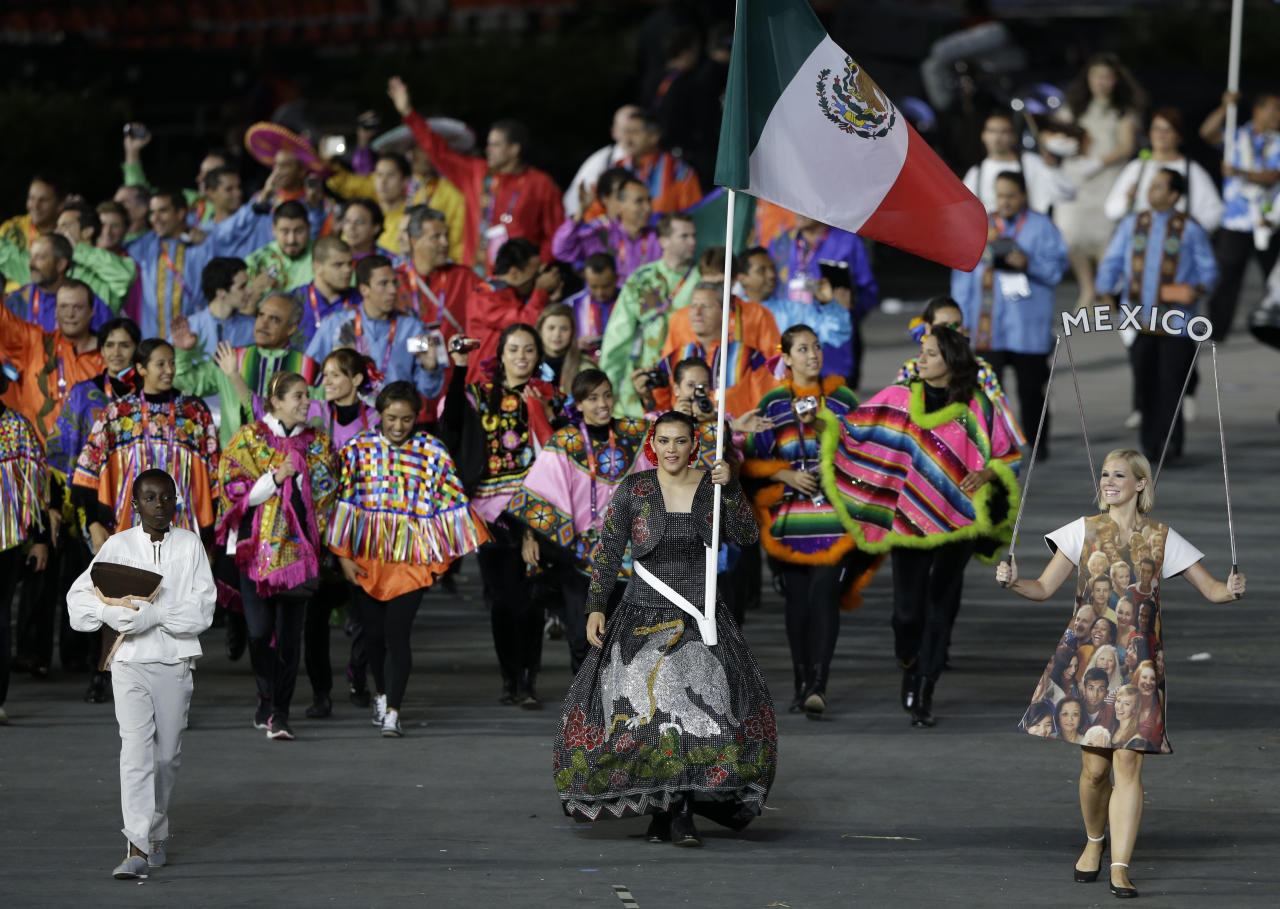 Mexico's Maria del Rosario Espinoza carries the flag during the Opening Ceremony at the 2012 Summer Olympics, Friday, July 27, 2012, in London. (AP Photo/Mark Humphrey)