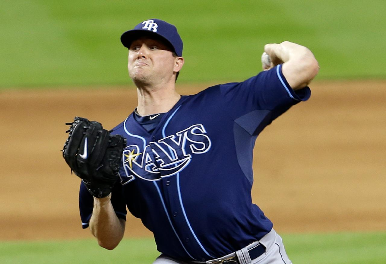 Tampa Bay Rays relief pitcher Jake McGee pitches against the Miami Marlins during an interleague baseball game in Miami, Monday, June 2, 2014. (AP Photo/Alan Diaz)