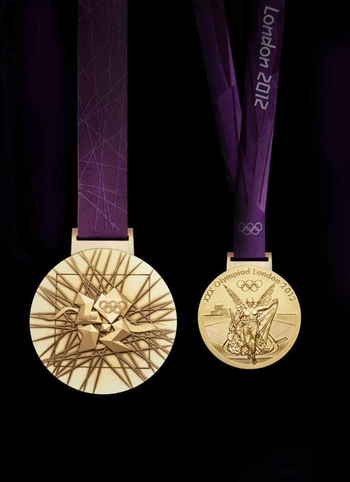 In this image made available by the London Organising Committee of the Olympic  Games on Wednesday July 27, 2011 shows London 2012 Olympic gold medal designed by British artist David Watkins. The front of the medal is on the right, all medals are 85mm in diameter. (AP Photo/LOCOG, HO)