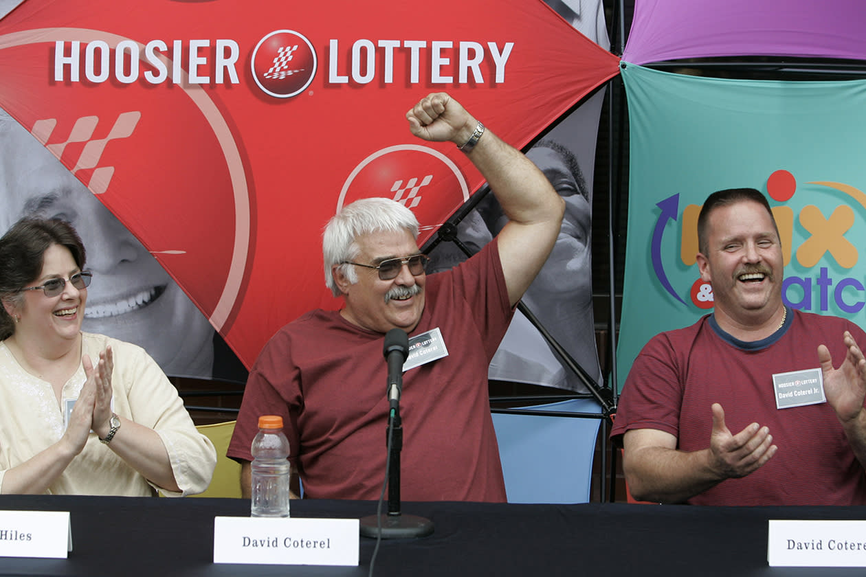 <b>$314.3 million</b><br><br>Winners of the $314.3 million Powerball jackpot from the Aug. 25, 2007 drawing David W. Coterel, center, his daughter Lynn Hiles, left, and son David W. Coterel Jr. cheer as they were asked what their favorite lottery is after they claimed the prize in Indianapolis, Monday, Sept. 10, 2007. The trio took the lump sum payment of $145.9 million.