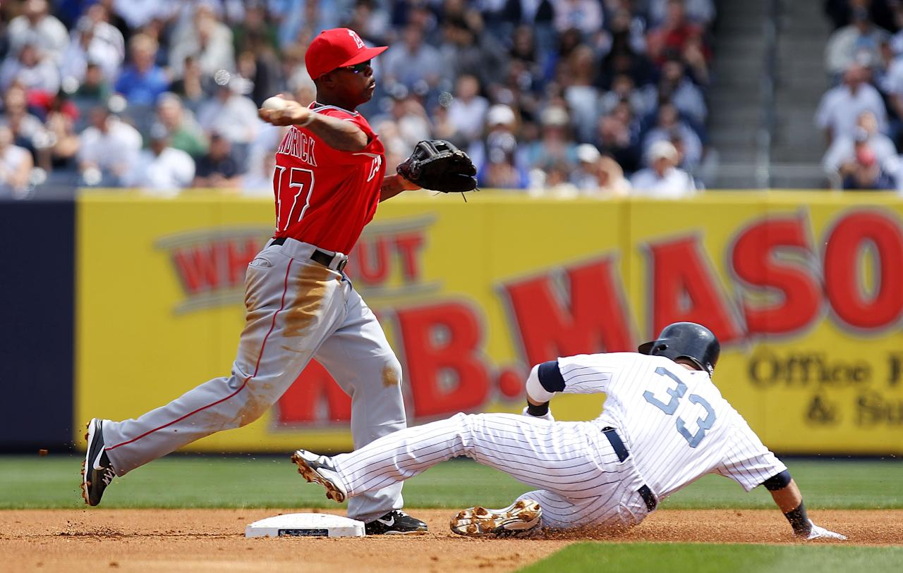 NEW YORK, NY - APRIL 14: Howie Kendrick #47 of the Los Angeles Angels unsuccessfully attempts to turn a double play as Nick Swisher #33 of the New York Yankees slides into second at Yankee Stadium on April 14, 2012 in the Bronx borough of New York City.  (Photo by Nick Laham/Getty Images)