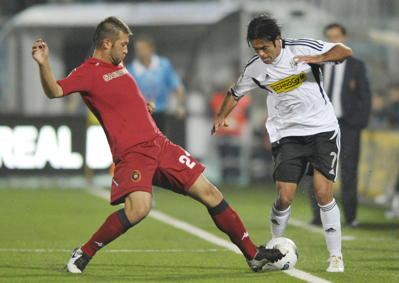 Cesena's Martins Eder of Brazil, right, vies for the ball with Cagliari's Michele Canini during their Serie A soccer match at Cesena Manuzzi stadium, Italy, Wednesday, Oct. 26, 2011. (AP Photo/Marco Vasini)