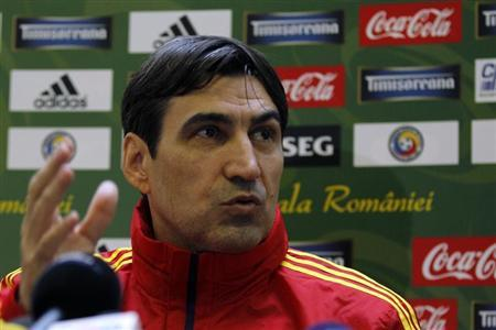 Romania's national soccer team coach Victor Piturca attends a news conference in Mogosoaia