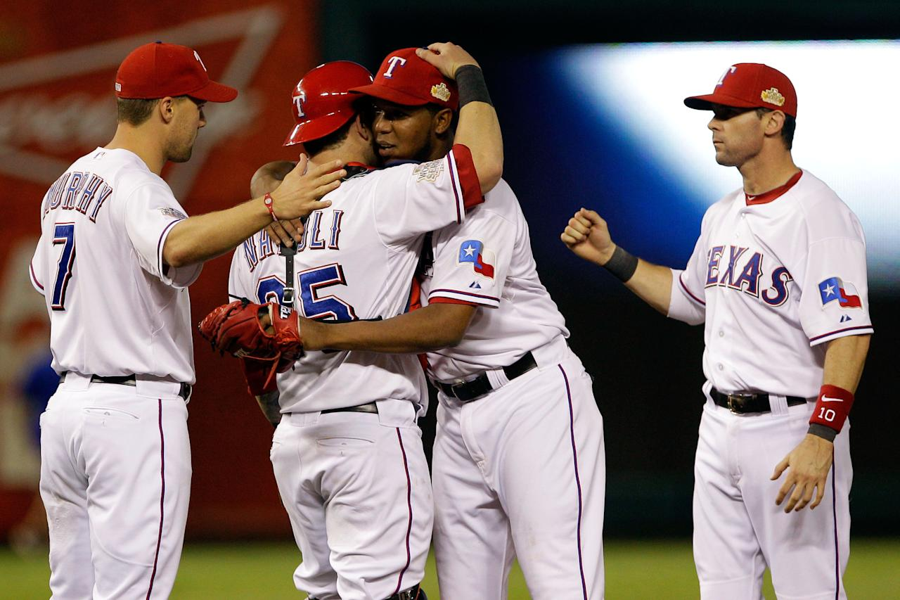 ARLINGTON, TX - OCTOBER 24:  Mike Napoli #25 and Neftali Feliz #30 of the Texas Rangers celebrate after defeating the St. Louis Cardinals 4--2 during Game Five of the MLB World Series at Rangers Ballpark in Arlington on October 24, 2011 in Arlington, Texas.  (Photo by Rob Carr/Getty Images)