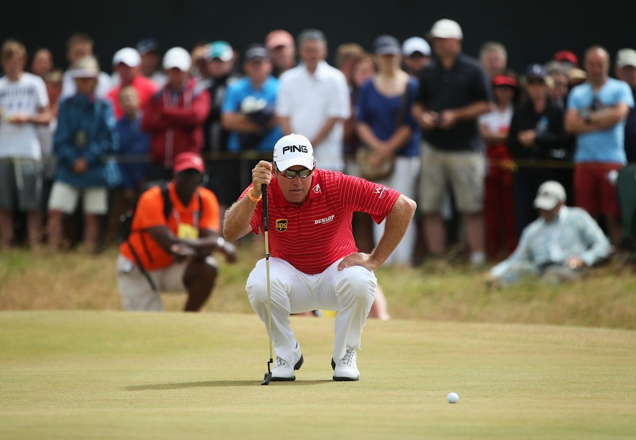 GULLANE, SCOTLAND - JULY 21: Lee Westwood of England lines up a putt on the 1st green during the final round of the 142nd Open Championship at Muirfield on July 21, 2013 in Gullane, Scotland. (Photo by Andy Lyons/Getty Images)