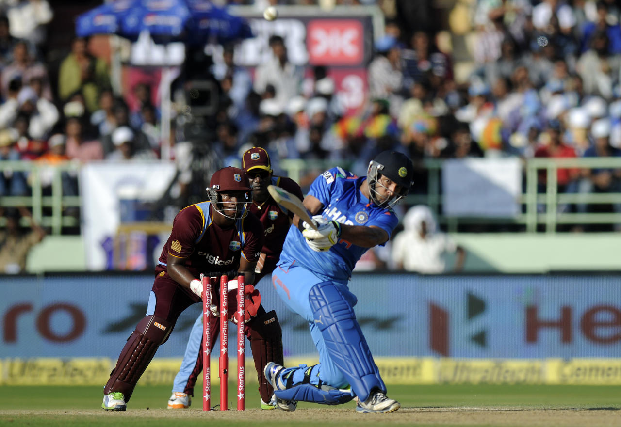 Yuvraj Singh of India bats during the second Star Sports One Day International (ODI) match between India and The West Indies held at the Dr. Y.S. Rajasekhara Reddy ACA-VDCA Cricket Stadium, Vishakhapatnam, India on the 24th November 2013  Photo by: Pal Pillai - BCCI - SPORTZPICS   Use of this image is subject to the terms and conditions as outlined by the BCCI. These terms can be found by following this link:  http://sportzpics.photoshelter.com/gallery/BCCI-Image-Terms/G0000ahUVIIEBQ84/C0000whs75.ajndY