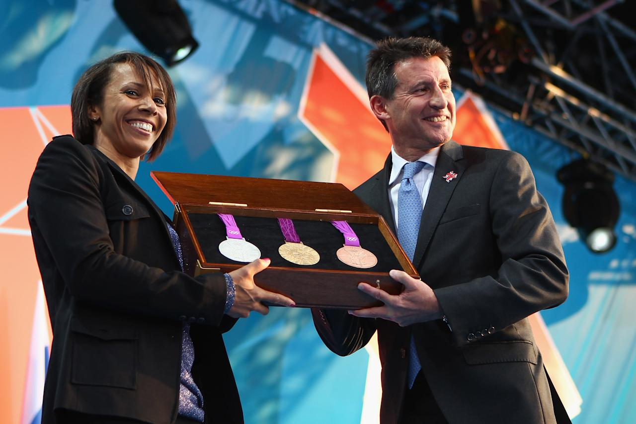 LONDON, ENGLAND - JULY 27:  Dame Kelly Holmes and LOCOG Chairman Sebastian Coe present the olympic medals during  the' London 2012 - One Year To Go' ceremony in Trafalgar Square on July 27, 2011 in London, England. The one year countdown to the London 2012 Olympic games was marked with a unique ceremony in Trafalgar Square, with IOC President Jacques Rogge inviting the world's athletes to compete in next summer's games.  (Photo by Clive Mason/Getty Images)