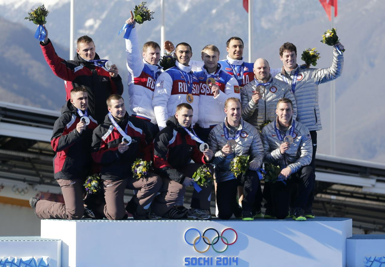 (L-R) Second-placed Latvia's team, winners Russia's team and third-placed team of the U.S.pose during a medal ceremony for the four-man bobsleigh event at the Sochi 2014 Winter Olympics, at the Sanki Sliding Center in Rosa Khutor February 23, 2014. REUTERS/Murad Sezer (RUSSIA - Tags: SPORT BOBSLEIGH OLYMPICS)