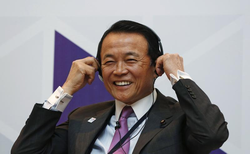 Japan's Deputy PM Aso adjusts his headphones during a seminar at the ADB's 46th annual board meeting in Greater Noida