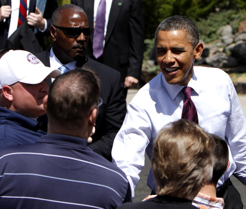 Obama seeks to undercut Romney's record on jobs