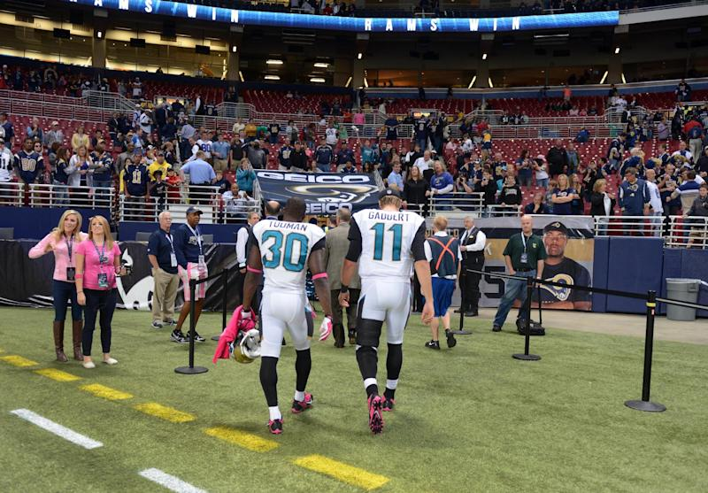 Jacksonville Jaguars quarterback Blaine Gabbert (11) and teammate running back Jordan Todman (30) walk off the field following a 34-20 loss to the St. Louis Rams in an NFL football game Sunday, Oct. 6, 2013, in St. Louis. Gabbert left the game in the third quarter with a reported hamstring injury