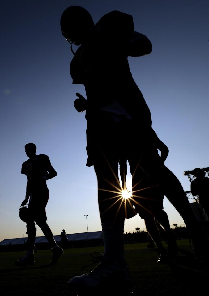 Atlanta Falcons quarterbacks Jeff Matthews, right, and Matt Ryan, left, jog onto the field for an NFL football training camp practice Thursday, Aug. 14, 2014, in Houston. The Falcons are practicing with the Houston Texans before their preseason game Saturday. (AP Photo/David J. Phillip)