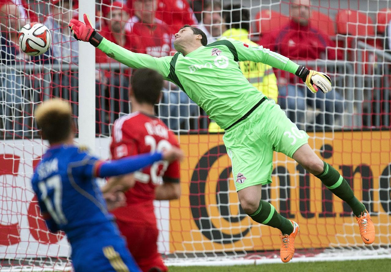 Toronto FC goalkeeper Julio Cesar maikes a save during second half MLS action against the Colorado Rapids in Toronto on Saturday, April 12, 2014. (AP Photo/The Canadian Press, Frank Gunn)