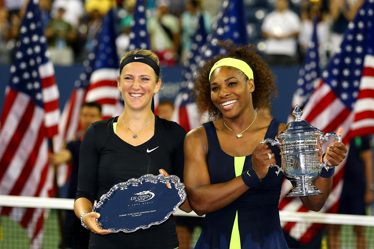 NEW YORK, NY - SEPTEMBER 09:  Serena Williams of the United States poses with the championship trophy next to Victoria Azarenka of Belarus following her victory in the women's singles final match on Day Fourteen of the 2012 US Open at USTA Billie Jean King National Tennis Center on September 9, 2012 in the Flushing neighborhood of the Queens borough of New York City.  (Photo by Al Bello/Getty Images)