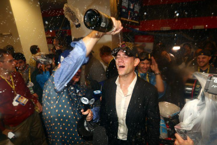 Theo Epstein gets showered in champagne by Bill Murray. (Getty Images)