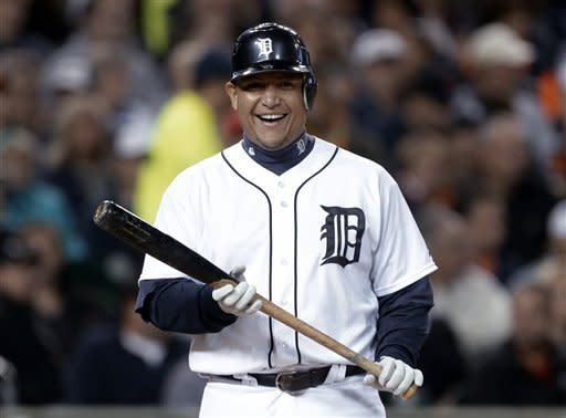 Detroit Tigers' Miguel Cabrera smiles while being intentionally walked by the Oakland Athletics during the third inning of a baseball game in Detroit, Wednesday, Sept. 19, 2012. (AP Photo/Paul Sancya)