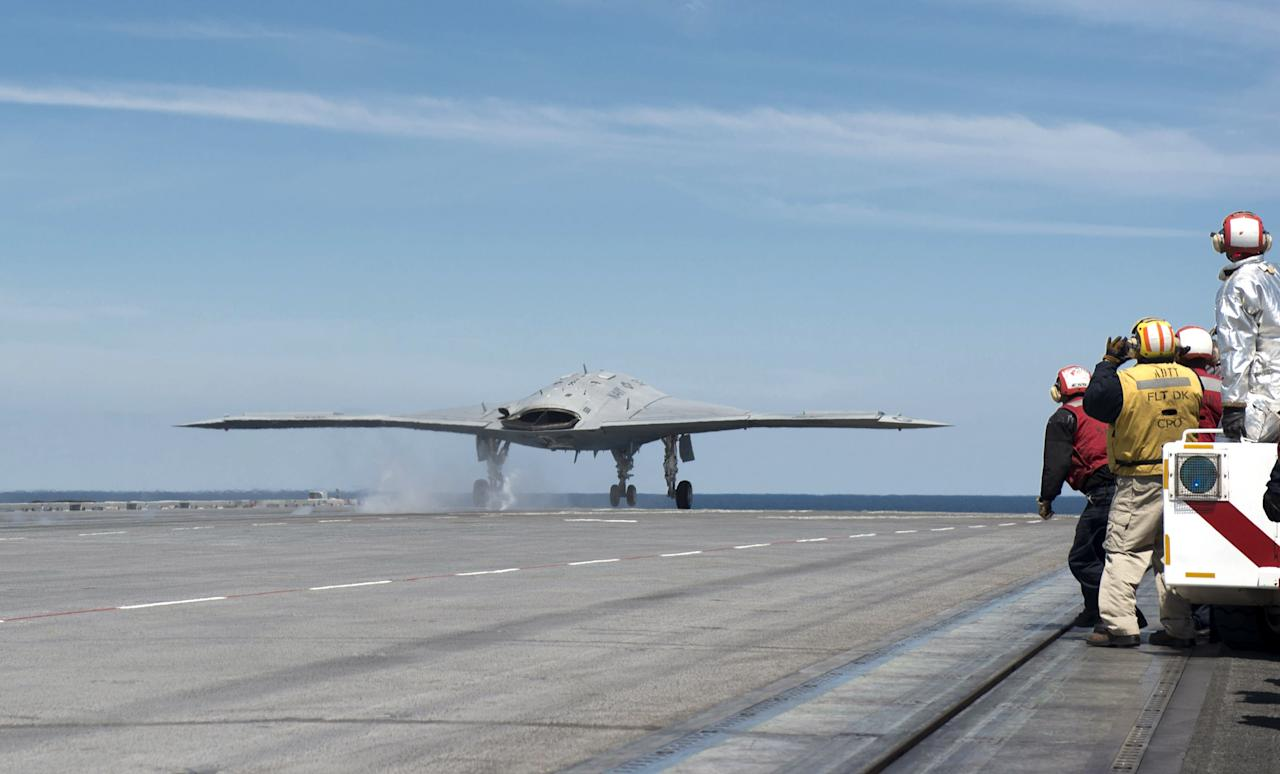 ATLANTIC OCEAN - MAY 14:  In this handout released by the U.S. Navy, An X-47B Unmanned Combat Air System (UCAS) demonstrator launches from the flight deck of the aircraft carrier USS George H.W. Bush (CVN 77) May 14, 2013 in the Atlantic Ocean. George H.W. Bush is the first aircraft carrier to sucessfully catapult-launch an unmanned aircraft from its flight deck. The Navy plans to have unmanned aircraft on each of its carriers to be used for surveillance and be armed and used in combat roles.  (Photo by Mass Communication Specialist 2nd Class Timothy Walter/U.S. Navy via Getty Images)