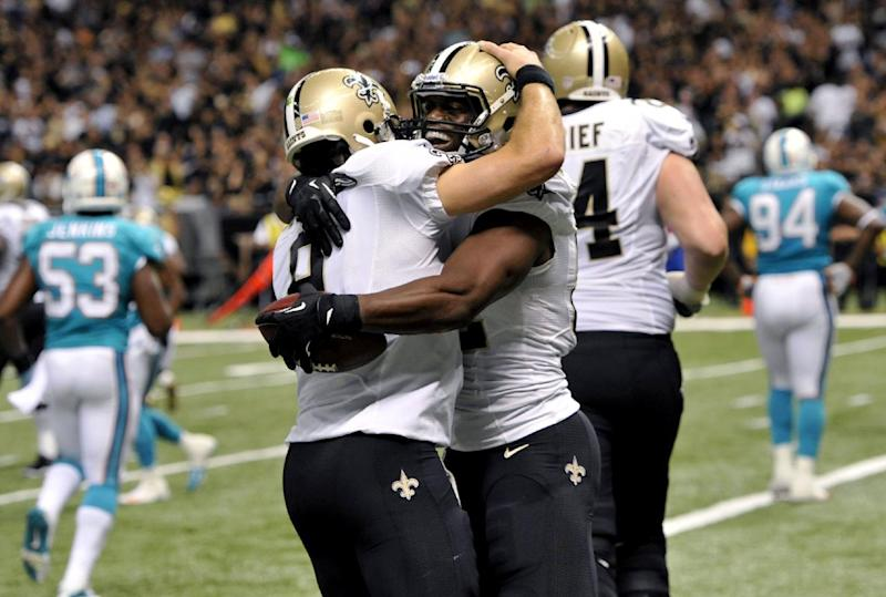 Brees leads Saints to 38-17 win over Dolphins