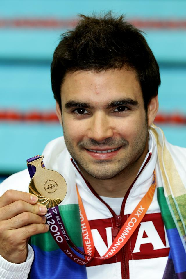 DELHI, INDIA - OCTOBER 11:  Alexandre Despatie of Canada poses with the gold medal won in the Men's 3m Springboard Final at Dr. S.P. Mukherjee Aquatics Complex during day eight of the Delhi 2010 Commonwealth Games on October 11, 2010 in Delhi, India.  (Photo by Matt King/Getty Images)