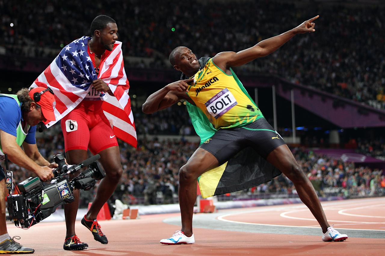 LONDON, ENGLAND - AUGUST 05:  Bronze medalist  Justin Gatlin of the United States and gold medalist Usain Bolt of Jamaica celebrate after competing in the Men?s 100m Final on Day 9 of the London 2012 Olympic Games at the Olympic Stadium on August 5, 2012 in London, England.  (Photo by Michael Steele/Getty Images)