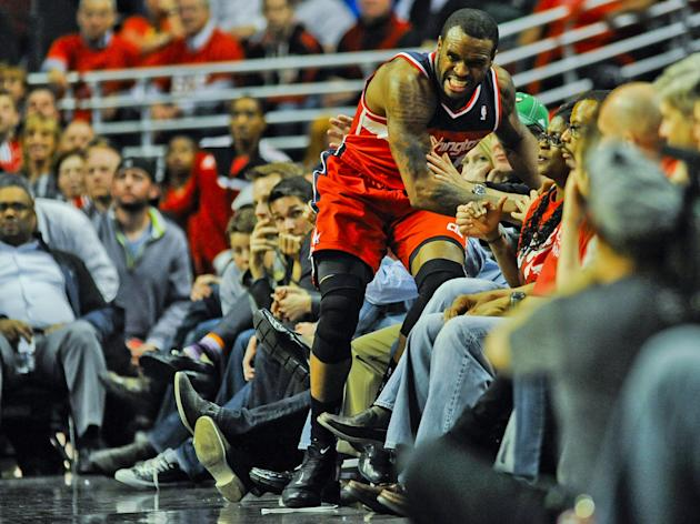 Trevor Booker gives the Jazz a dive in the crowd for loose balls kind of dude. (Matt Marton-USA TODAY Sports)