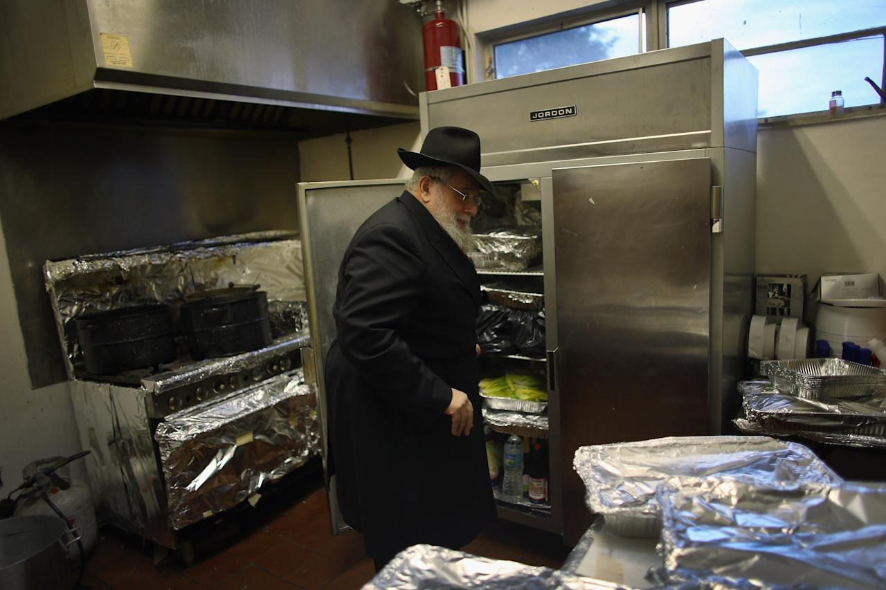 MIAMI BEACH, FL - MARCH 25:  Rabbi Efraim Katz checks on the kosher food in the kitchen as he leads a community Passover Seder at Beth Israel synagogue  on March 25, 2013 in Miami Beach, Florida. The community Passover Seder that served around 150 people has been held for the past 30 years and is welcome to anyone in the community that wants to commemorate the emancipation of the Israelites from slavery in ancient Egypt.  (Photo by Joe Raedle/Getty Images)