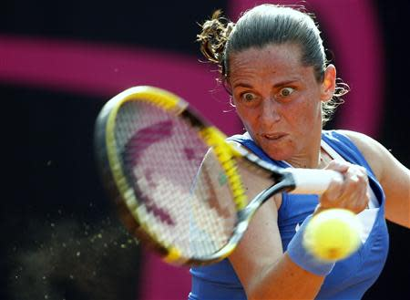 Italy's Vinci hits a return to Russia's Panova during their Fed Cup World Group women's tennis final match in Cagliari