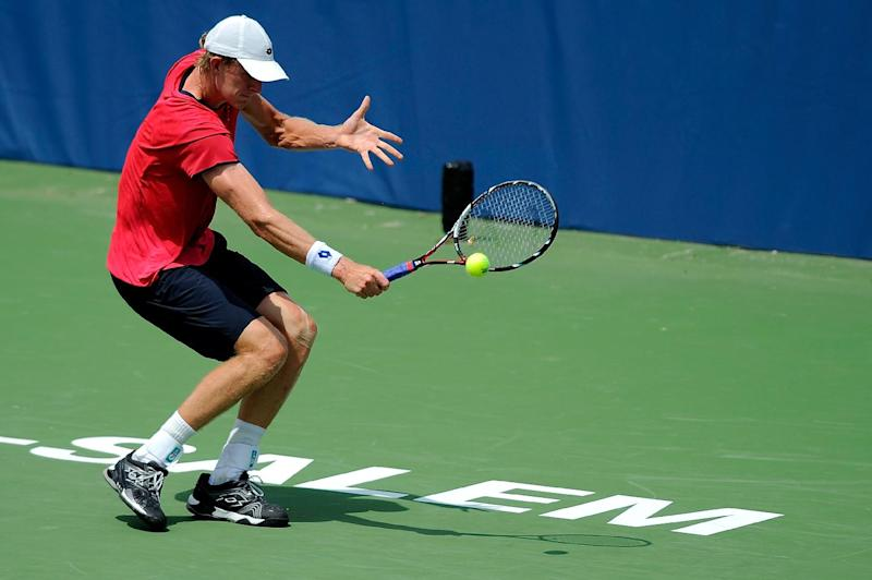 Kevin Anderson of South Africa returns a shot from Adrian Mannarino of France during the Winston-Salem Open at Wake Forest University on August 19, 2014 in Winston Salem, North Carolina