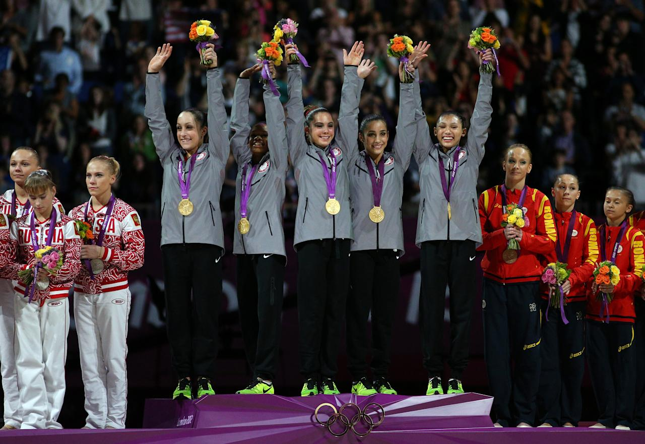 LONDON, ENGLAND - JULY 31:  Jordyn Wieber, Gabrielle Douglas, Mc Kayla Maroney, Alexandra Raisman and Kyla Ross of the United States celebrate on the podium after winning the gold medal in the Artistic Gymnastics Women's Team final on Day 4 of the London 2012 Olympic Games at North Greenwich Arena on July 31, 2012 in London, England.  (Photo by Cameron Spencer/Getty Images)