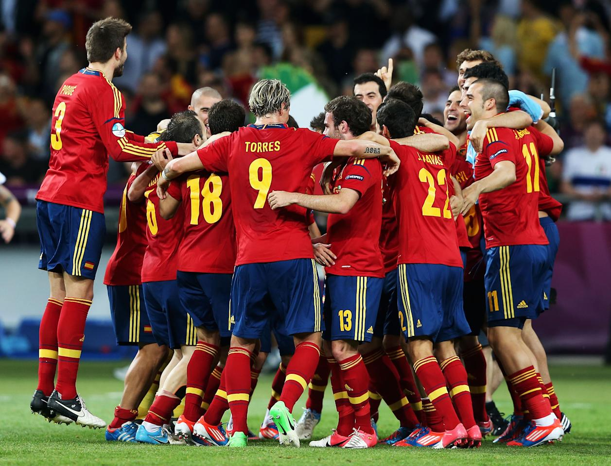 KIEV, UKRAINE - JULY 01:  Spain players celebrate victory after the UEFA EURO 2012 final match between Spain and Italy at the Olympic Stadium on July 1, 2012 in Kiev, Ukraine.  (Photo by Alex Grimm/Getty Images)