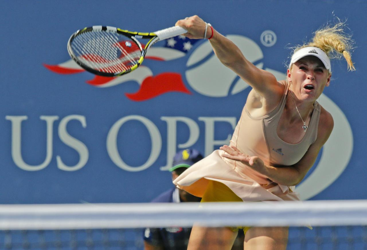 Caroline Wozniacki, of Denmark, serves against Peng Shuai, of China, during the semifinals of the 2014 U.S. Open tennis tournament, Friday, Sept. 5, 2014, in New York. (AP Photo/Charles Krupa)