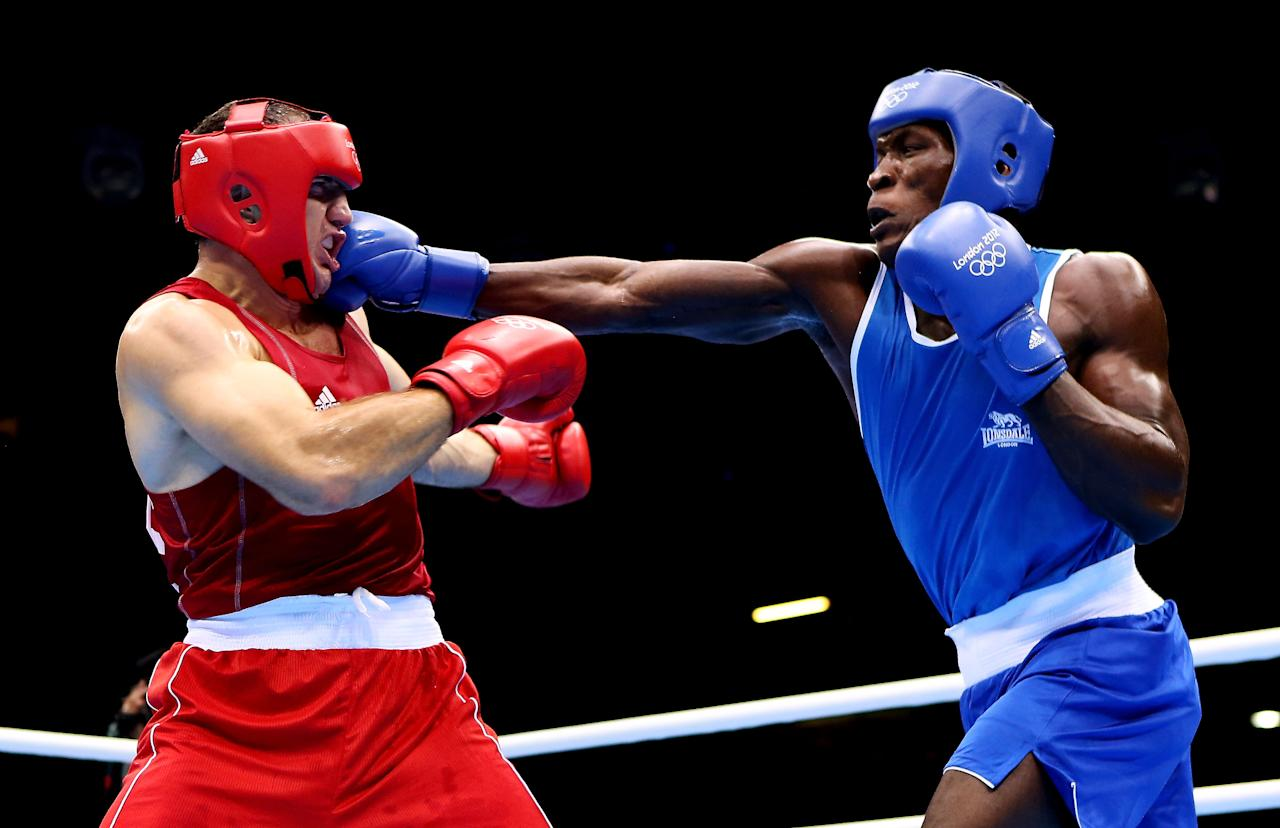 LONDON, ENGLAND - AUGUST 01:  Magomedrasul Medzhidov of Azerbeijan (L) in action with Meji Mwanba of DR Congo during the Men's Super Heavy (91 kg) Boxing on Day 5 of the London 2012 Olympic Games at ExCeL on August 1, 2012 in London, England.  (Photo by Scott Heavey/Getty Images)