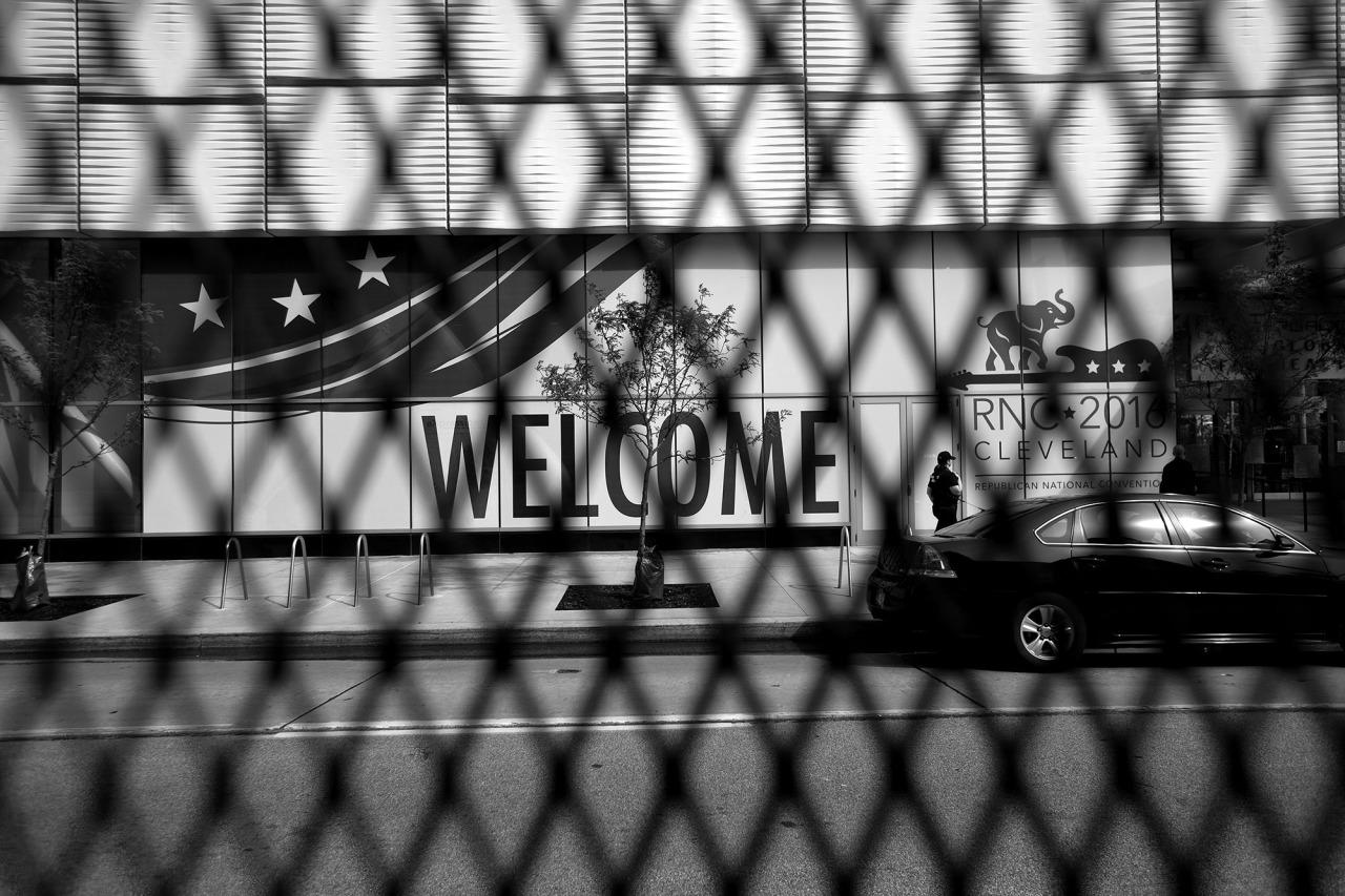 <p>Welcome signs are obscured by security fencing along the perimeter of the Republican National Convention Monday in Cleveland. (Photo: Khue Bui for Yahoo News)</p>