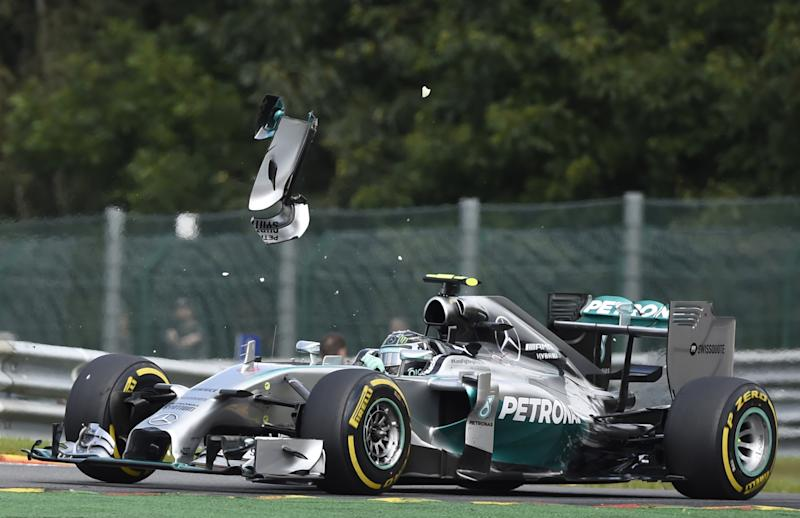 A piece of wing flys over the Mercedes-AMG of German driver Nico Rosberg after a collision with teammate and British driver Lewis Hamilton in Spa on August 24, 2014 during the Belgium Formula One Grand Prix