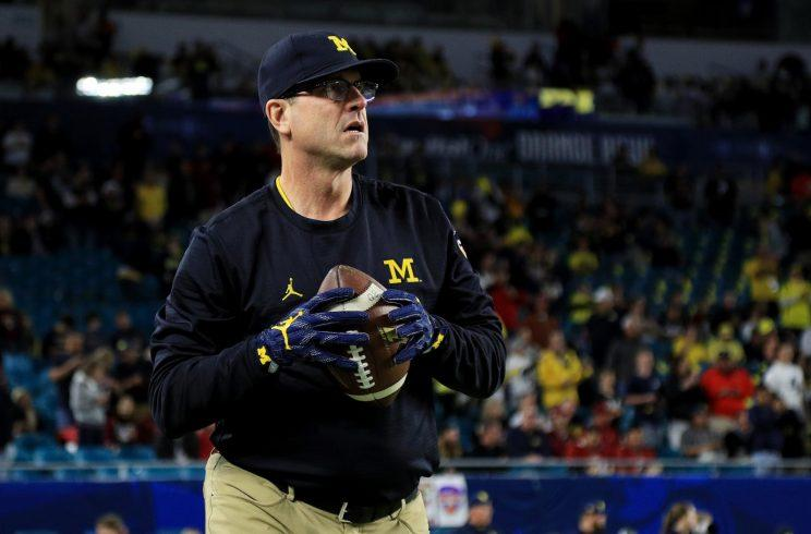 Michigan Football Coach Jim Harbaugh Trades Glasses For Goggles